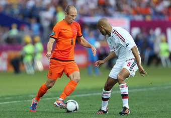 KHARKOV, UKRAINE - JUNE 09:  Arjen Robben of Netherlands tries to go past Simon Poulsen of Denmark during the UEFA EURO 2012 group B match between Netherlands and Denmark at Metalist Stadium on June 9, 2012 in Kharkov, Ukraine.  (Photo by Ian Walton/Getty