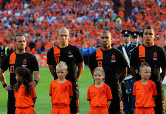 ROTTERDAM, NETHERLANDS - MAY 30:  Wesley Sneijder (#10) , Arjen Robben (#11), Nigel de Jong (#8) and Gregory van der Wiel (#2) of Netherlands stand for the national anthem prior to the International Friendly between the Netherlands and Slovakia at De Kuip