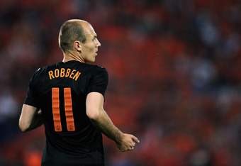 ROTTERDAM, NETHERLANDS - MAY 30:  Arjen Robben (#11) of Netherlands in action during the International Friendly between the Netherlands and Slovakia at De Kuip Stadion on May 30, 2012 in Rotterdam, Netherlands.  (Photo by Dean Mouhtaropoulos/Getty Images)