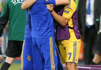 Shevchenko embraces Ukrainian coach Oleg Blokhim who never lost confidence in his team's star striker.