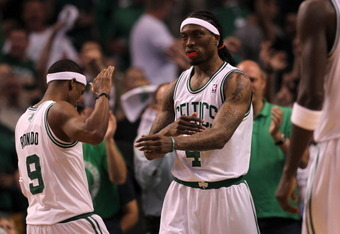 BOSTON, MA - JUNE 01:  Marquis Daniels #4 and Rajon Rondo #9 of the Boston Celtics react in the second half after Daniels scored a 2-point basket in the second half against the Miami Heat in Game Three of the Eastern Conference Finals in the 2012 NBA Play