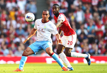 LONDON, ENGLAND - MARCH 24:  Gabriel Agbonlahor of Aston Villa (L) and Johan Djourou of Asrenal compete for the ball during the Barclays Premier League match between Arsenal and Aston Villal at Emirates Stadium on March 24, 2012 in London, England.  (Phot