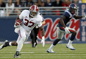 OXFORD, MS - OCTOBER 15:  Defensive back Robert Lester #37 of the Alabama Crimson Tide runs after intercepting a pass in the third quarter against the Ole Miss Rebels on October 15, 2011 at Vaught-Hemingway Stadium in Oxford, Mississippi. (Photo by Butch