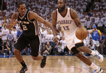 OKLAHOMA CITY, OK - JUNE 06:   James Harden #13 of the Oklahoma City Thunder drives on Kawhi Leonard #2 of the San Antonio Spurs in Game Six of the Western Conference Finals in the 2012 NBA Playoffs on June 6, 2012 at the Chesapeake Energy Arena in Oklaho