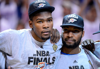 OKLAHOMA CITY, OK - JUNE 06:  Kevin Durant #35 and Lazar Hayward #11 of the Oklahoma City Thunder look on after defeating the San Antonio Spurs to win the Western Conference Finals of the 2012 NBA Playoffs at Chesapeake Energy Arena on June 6, 2012 in Okl