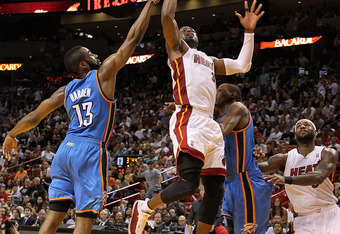 OKC's James Harden contests the Heat's Dwayne Wade drive earlier in the season as LeBron James looks on.