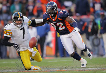 DENVER, CO - JANUARY 08:  Ben Roethlisberger #7 of the Pittsburgh Steelers looses the ball against Elvis Dumervil #92 of the Denver Broncos during the AFC Wild Card Playoff game at Sports Authority Field at Mile High on January 8, 2012 in Denver, Colorado