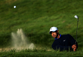 DALY CITY, CA - JUNE 12:  Tiger Woods of the United States hits from a bunker during a practice round prior to the start of the 112th U.S. Open at The Olympic Club on June 12, 2012 in Daly City, California.  (Photo by Andrew Redington/Getty Images)
