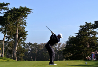 DALY CITY, CA - JUNE 12:  Tiger Woods of the United States hits a tee shot during a practice round prior to the start of the 112th U.S. Open at The Olympic Club on June 12, 2012 in Daly City, California.  (Photo by Andrew Redington/Getty Images)