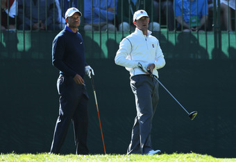 San Francisco, CA - JUNE 12:  Amateur Cameron Wilson (R) of the United States watches his tee shot alongside Tiger Woods (L) of the United States during a practice round prior to the start of the 112th U.S. Open at The Olympic Club on June 12, 2012 in San
