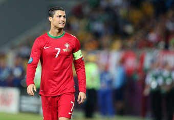 L'VIV, UKRAINE - JUNE 09:  Cristiano Ronaldo of Portugal looks on during the UEFA EURO 2012 group B match between Germany and Portugal at Arena Lviv on June 9, 2012 in L'viv, Ukraine.  (Photo by Joern Pollex/Getty Images)
