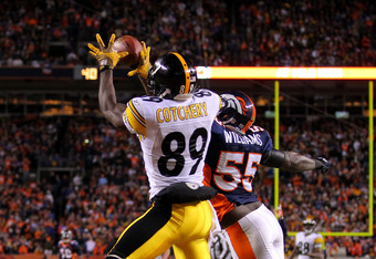 DENVER, CO - JANUARY 08:  Jerricho Cotchery #89 of the Pittsburgh Steelers catches a touchdown pass to tie the game in fourth quarter against D.J. Williams #55 of the Denver Broncos during the AFC Wild Card Playoff game at Sports Authority Field at Mile H