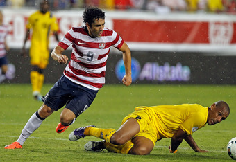 TAMPA, FL - JUNE 08:  Forward Herculez Gomez #9 of Team USA battles defender Marc Joseph #5 of Team Antigua and Barbuda for the ball during the FIFA World Cup Qualifier Match at Raymond James Stadium on June 8, 2012 in Tampa, Florida.  (Photo by J. Meric/