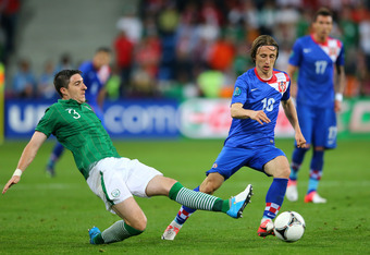 POZNAN, POLAND - JUNE 10: Stephen Ward of Republic of Ireland and Luka Modric of Croatia compete for the ball during the UEFA EURO 2012 group C between Ireland and Croatia at The Municipal Stadium on June 10, 2012 in Poznan, Poland.  (Photo by Christof Ko