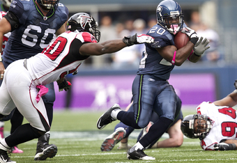 SEATTLE, WA - OCTOBER 2: Running back Justin Forsett #20 of the Seattle Seahawks escapes the grasp of linebacker Curtis Lofton #50 of the Atlanta Falcons during play at CenturyLink Field on October 2, 2011 in Seattle, Washington. The Falcons won the game