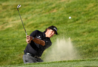 SAN FRANCISCO, CA - JUNE 12:  Phil Mickelson of the United States hits a shot from a bunker during a practice round prior to the start of the 112th U.S. Open at The Olympic Club on June 12, 2012 in San Francisco, California.  (Photo by Ezra Shaw/Getty Ima