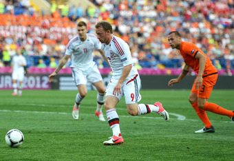 KHARKOV, UKRAINE - JUNE 09:  Michael Krohn-Dehli of Denmark breaks through to score their first goal during the UEFA EURO 2012 group B match between Netherlands and Denmark at Metalist Stadium on June 9, 2012 in Kharkov, Ukraine.  (Photo by Lars Baron/Get