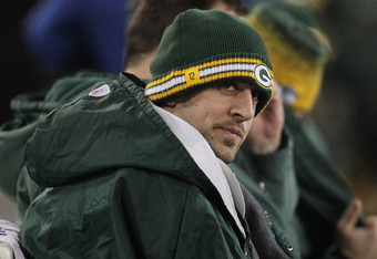 GREEN BAY, WI - DECEMBER 11: Aaron Rodgers #12 of the Green Bay Packers sits on the bench in the 4th quarter of a game against the Oakland Raiders at Lambeau Field on December 11, 2011 in Green Bay, Wisconsin. The Packers defeated the Raiders 46-16. (Phot