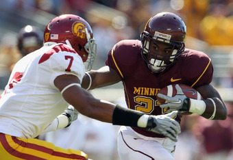 MINNEAPOLIS - SEPTEMBER 18:  Eskridge DeLeon #23 of the Minnesota Golden Gophers carries the ball as T.J. McDonald #7 of the USC Trojans defends during the game on September 18, 2010 at TCF Bank Stadium in Minneapolis, Minnesota.  (Photo by Jamie Squire/G