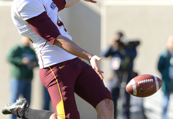 EAST LANSING, MI - NOVEMBER 05:  Dan Orseske #41 of the Minnesota Golden Gophers punts the football in the first quarter of the game against the Michigan State Spartans at Spartan Stadium on November 5, 2011 in East Lansing, Michigan. The Spartans defeate