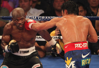 LAS VEGAS, NV - JUNE 09:  (R-L) Manny Pacquiao lands a left to the head of Timothy Bradley during their WBO welterweight title fight at MGM Grand Garden Arena on June 9, 2012 in Las Vegas, Nevada.  (Photo by Jeff Bottari/Getty Images)