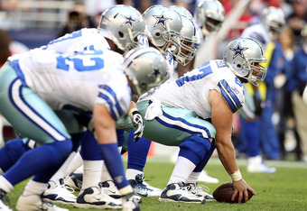 GLENDALE, AZ - DECEMBER 04:  Center Phil Costa #67 of the Dallas Cowboys in action against the Arizona Cardinals during the NFL game at the University of Phoenix Stadium on December 4, 2011 in Glendale, Arizona.  The Cardinals defeated the Cowboys 19-13 i