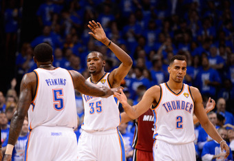OKLAHOMA CITY, OK - JUNE 12:  (R-L) Thabo Sefolosha #2, Kevin Durant #35 and Kendrick Perkins #5 of the Oklahoma City Thunder celebrate a play in the third quarter while taking on the Miami Heat in Game One of the 2012 NBA Finals at Chesapeake Energy Aren