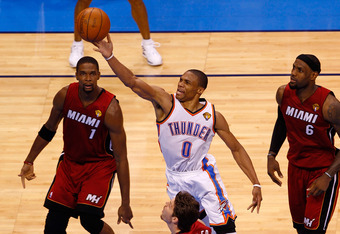 OKLAHOMA CITY, OK - JUNE 12:  Russell Westbrook #0 of the Oklahoma City Thunder goes up for a shot between Chris Bosh #1 and LeBron James #6 of the Miami Heat in the second half in Game One of the 2012 NBA Finals at Chesapeake Energy Arena on June 12, 201