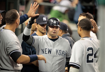 DETROIT, MI - JUNE 01: Nick Swisher #33 of the New York Yankees celebrates after scoring on the double from Andruw Jones #22 in the eight inning during the game against the Detroit Tigers at Comerica Park on June 1, 2012 in Detroit, Michigan. The Yankees