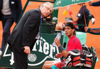 PARIS, FRANCE - JUNE 11:  Rafael Nadal of Spain talks with referee Stefan Fransson as rain begins to fall during the men's singles final against Novak Djokovic of Serbia during day 16 of the French Open at Roland Garros on June 11, 2012 in Paris, France.