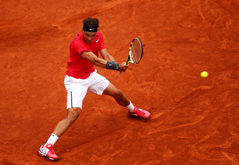 PARIS, FRANCE - JUNE 10:  Rafael Nadal of Spain plays a backhand during the men's singles final against Novak Djokovic of Serbia on day 15 of the French Open at Roland Garros on June 10, 2012 in Paris, France.  (Photo by Clive Brunskill/Getty Images)