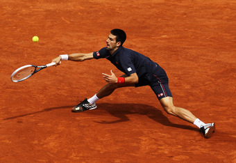 PARIS, FRANCE - JUNE 11:  Novak Djokovic of Serbia plays a forehand during the men's singles final against Rafael Nadal of Spain on day 16 of the French Open at Roland Garros on June 11, 2012 in Paris, France.  (Photo by Matthew Stockman/Getty Images)