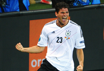 L'VIV, UKRAINE - JUNE 09:  Mario Gomez of Germany celebrates scoring their first goal during the UEFA EURO 2012 group B match between Germany and Portugal at Arena Lviv on June 9, 2012 in L'viv, Ukraine.  (Photo by Laurence Griffiths/Getty Images)