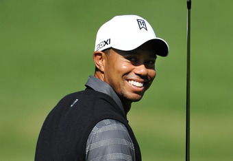 SAN FRANCISCO, CA - JUNE 11:  Tiger Woods of the United States smiles during a practice round prior to the start of the 112th U.S. Open at The Olympic Club on June 11, 2012 in San Francisco, California.  (Photo by Stuart Franklin/Getty Images)