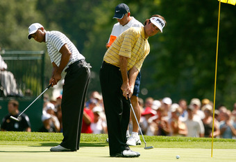 CHASKA, MN - AUGUST 10:  Bubba Watson, (R) and Tiger Woods watch putts on the 18th green during a practice round prior to the start of the 91st PGA Championship at the Hazeltine Golf Club on August 10, 2009 in Chaska, Minnesota.  (Photo by Scott Halleran/