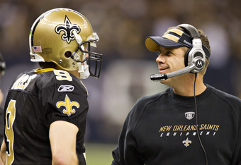 NEW ORLEANS, LA - DECEMBER 26:   Quarterback Drew Brees #9 and Head Coach Sean Payton of the New Orleans Saints talk on the sidelines during a game against the Atlanta Falcons at Mercedes-Benz Superdome on December 26, 2011 in New Orleans, Louisiana.  The