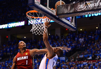 OKLAHOMA CITY, OK - JUNE 12:  Russell Westbrook #0 of the Oklahoma City Thunder goes up for a shot against Chris Bosh #1 of the Miami Heat in the second quarter in Game One of the 2012 NBA Finals at Chesapeake Energy Arena on June 12, 2012 in Oklahoma Cit
