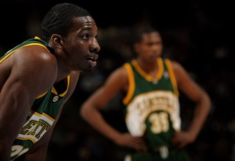 DENVER - MARCH 16:  Jeff Green #22 and Kevin Durant #35 of the Seattle SuperSonics await action against the Denver Nuggets at the Pepsi Center on March 16, 2008 in Denver, Colorado. The Nuggets defeated the Sonics 168-116. NOTE TO USER: User expressly ack