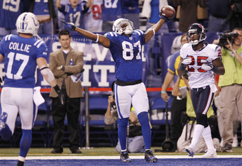 INDIANAPOLIS, IN - DECEMBER 22: Reggie Wayne #87 of the Indianapolis Colts celebrates after catching the game-winning touchdown pass against Kareem Jackson #25 of the Houston Texans at Lucas Oil Stadium on December 22, 2011 in Indianapolis, Indiana. The C