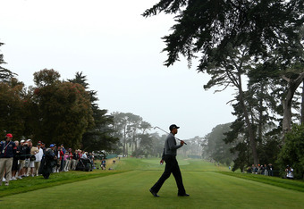 SAN FRANCISCO, CA - JUNE 13:  Tiger Woods of the United States walks across a tee box during a practice round prior to the start of the 112th U.S. Open at The Olympic Club on June 13, 2012 in San Francisco, California.  (Photo by Ezra Shaw/Getty Images)