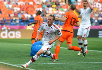 KHARKOV, UKRAINE - JUNE 09:  Michael Krohn-Dehli of Denmark turns to celebrate scoring their first goal during the UEFA EURO 2012 group B match between Netherlands and Denmark at Metalist Stadium on June 9, 2012 in Kharkov, Ukraine.  (Photo by Lars Baron/