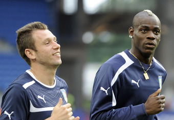 POZNAN, POLAND - JUNE 13:  (L-R) Antonio Cassano and Mario Balotelli of Italy during a UEFA EURO 2012 training session at the Municipal Stadium on June 13, 2012 in Poznan, Poland.  (Photo by Claudio Villa/Getty Images)