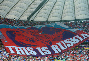 WARSAW, POLAND - JUNE 12:  A giant Russian flag is seen during the UEFA EURO 2012 group A match between Poland and Russia at The National Stadium on June 12, 2012 in Warsaw, Poland.  (Photo by Shaun Botterill/Getty Images)