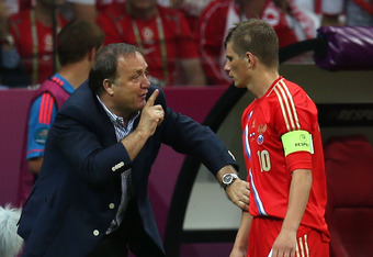 WARSAW, POLAND - JUNE 12:  Manager Dick Advocaat of Russia has words with Andrey Arshavin of Russia during the UEFA EURO 2012 group A match between Poland and Russia at The National Stadium on June 12, 2012 in Warsaw, Poland.  (Photo by Alex Grimm/Getty I