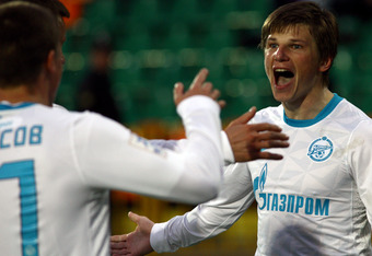 KAZAN, RUSSIA - MAY 02: Andrei Arshavin (R) of FC Zenit St. Petersburg celebrates after scoring a goal during the Russian Football League Championship match between FC Rubin Kazan and FC  Zenit St. Petersburg at the Tsentraliniy Stadium on May 02, 2012 in