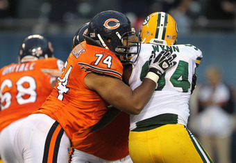 CHICAGO, IL - SEPTEMBER 25:  Chris Williams #74 and J'Marcus Webb #73 of the Chicago Bears block Jarius Wynn #94 of the Green Bay Packers at Soldier Field on September 25, 2011 in Chicago, Illinois. The Packers defeated the Bears 27-17.  (Photo by Jonatha