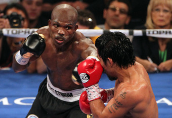 LAS VEGAS, NV - JUNE 09:  (L-R) Timothy Bradley lands a left to the head of Manny Pacquiao during their WBO welterweight title fight at MGM Grand Garden Arena on June 9, 2012 in Las Vegas, Nevada.  (Photo by Jeff Bottari/Getty Images)