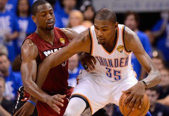 OKLAHOMA CITY, OK - JUNE 12:  Kevin Durant #35 of the Oklahoma City Thunder posts up Dwyane Wade #3 of the Miami Heat in the fourth quarter in Game One of the 2012 NBA Finals at Chesapeake Energy Arena on June 12, 2012 in Oklahoma City, Oklahoma. NOTE TO