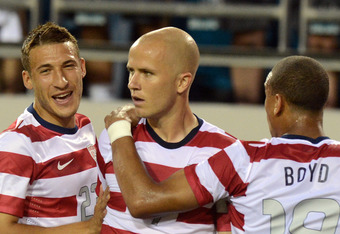 JACKSONVILLE, FL - MAY 26:   Michael Bradley #4 of Team USA is congratulated by his teammates Fabian Johnson #23 and Terrence Boyd #18 after Bradley scored a goal against Team Scotland on May 26, 2012 at EverBank Field in Jacksonville, Florida. (Photo by
