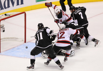 LOS ANGELES, CA - JUNE 11:  Adam Henrique #14 of the New Jersey Devils scores a goal against goaltender Jonathan Quick #32 of the Los Angeles Kings in Game Six of the 2012 Stanley Cup Final at Staples Center on June 11, 2012 in Los Angeles, California.  (